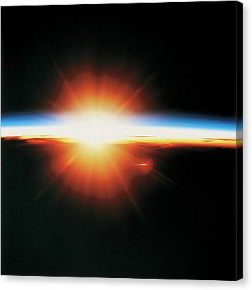 View Of The Sunrise From Space Canvas Print by Stockbyte