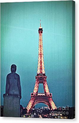 Viewing The Eiffel Tower Canvas Print by Paul Topp