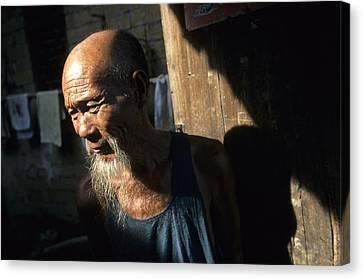 Village Elder At Doorway, Yangdi Canvas Print by Raymond Gehman