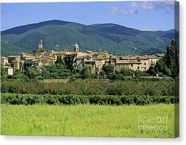 Village Of Lourmarin. Luberon. Vaucluse Canvas Print by Bernard Jaubert