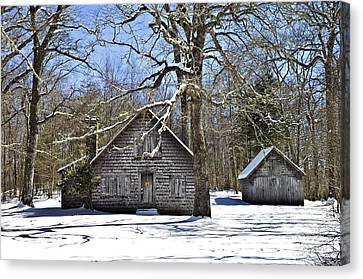 Vintage Buildings In The Winter Snow Canvas Print by Susan Leggett