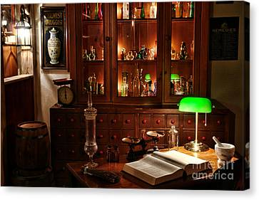 Vintage Chemist Desk In Apothecary Shop Canvas Print by Olivier Le Queinec