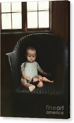 Vintage Dolls On Chair In Dark Room Canvas Print by Sandra Cunningham