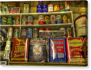 Vintage Garage Oil Cans Canvas Print by Bob Christopher