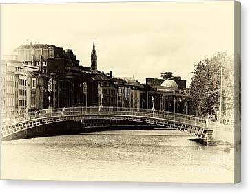 Vintage Ha'penny Bridge Canvas Print by John Rizzuto
