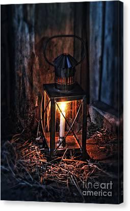 Vintage Lantern In A Barn Canvas Print by Jill Battaglia