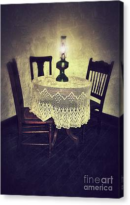 Vintage Table And Chairs By Oil Lamp Light Canvas Print