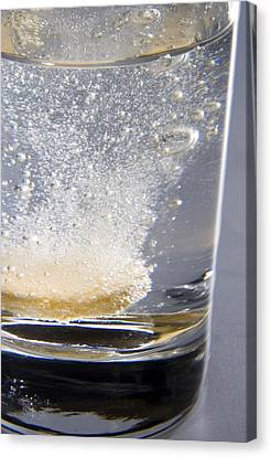 Vitamin Tablet Dissolving In Water Canvas Print by Sheila Terry