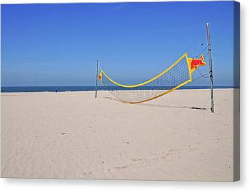Volleyball Net On Beach Canvas Print by Leuntje