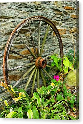Wagon Wheel And Stone Wall Canvas Print by Steven Ainsworth