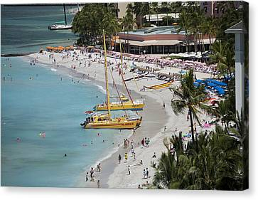 Waikiki Beach And Catamarans Canvas Print by Peter French