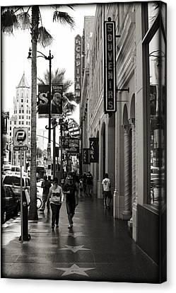 Walking In La Canvas Print by Ricky Barnard