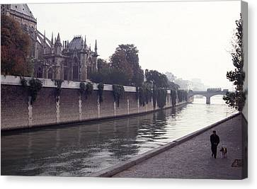 Canvas Print featuring the photograph Walking The Dog Along The Seine by Tom Wurl