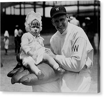 Canvas Print featuring the photograph Walter Johnson Holding A Baby - C 1924 by International  Images