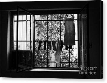 Washing Hanging Off Security Cage In An Apartment In Buenos Aires Canvas Print by Joe Fox