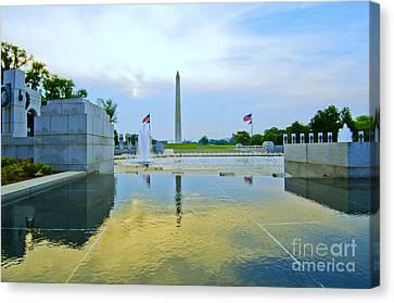 Canvas Print featuring the photograph Washington Monument And The World War II Memorial by Jim Moore