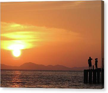 Watching A Sunset From The Jetty Canvas Print by Thepurpledoor