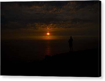 Watching The Sunset Canvas Print by Paul Howarth