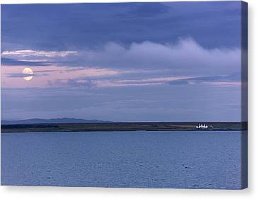 Water And Dark Clouds Canvas Print by John Short