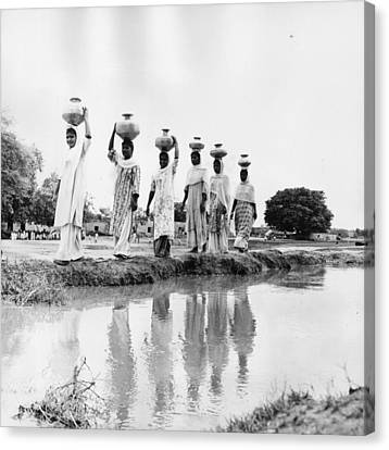 Water Carriers Canvas Print by Three Lions