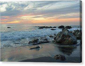 Water Washing Up On The Beach Canvas Print by Keith Levit