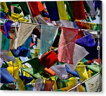 Canvas Print featuring the photograph Waving Prayer Flags by Don Schwartz