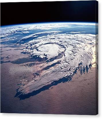 Weather Systems Above Earth Canvas Print by Stockbyte