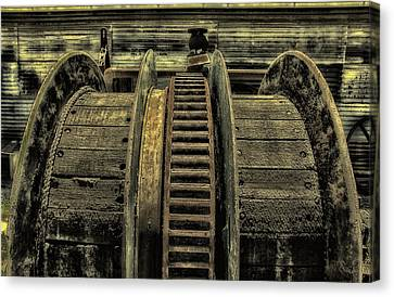 Wheel Of Industry Canvas Print by John Monteath