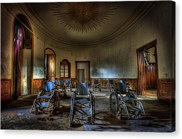 Wheelchairs Are Us Canvas Print by Nathan Wright