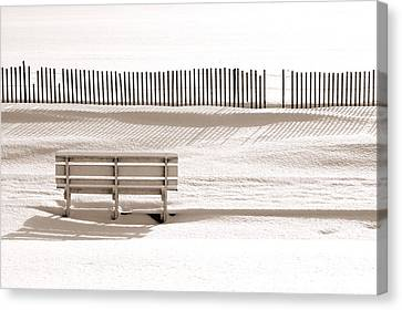 White Bench On A Winter Beach Sepia Canvas Print by Bill Pevlor