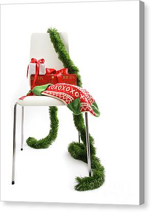 White Chair With Gifts And Garland On White  Canvas Print by Sandra Cunningham
