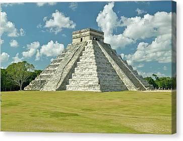 White Puffy Clouds Over The Mayan Pyramid Of Kukulkan (also Known As El Castillo) And Ruins At Chichen Itza, Yucatan Peninsula, Mexico Canvas Print by VisionsofAmerica/Joe Sohm