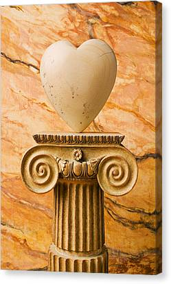 Pedestal Canvas Print - White Stone Heart On Pedestal by Garry Gay