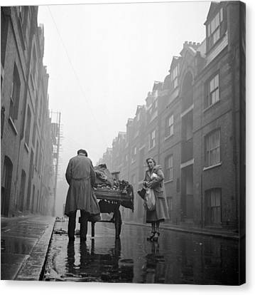 Whitechapel Street Canvas Print by John Chillingworth
