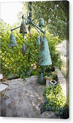 Wind Chimes In Garden Canvas Print by Andersen Ross