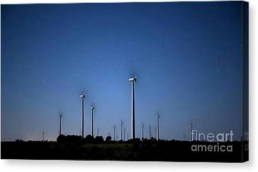 Wind Farm At Night Canvas Print by Keith Kapple