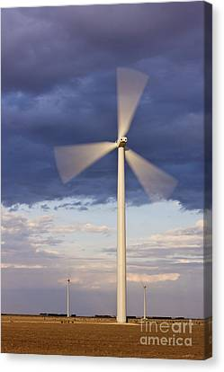 Wind Turbine Spinning At Dusk Canvas Print by Jeremy Woodhouse