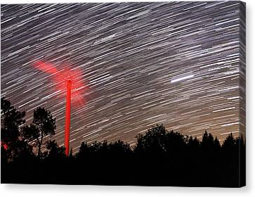 Wind Turbine Under Star Trails Canvas Print by Laurent Laveder