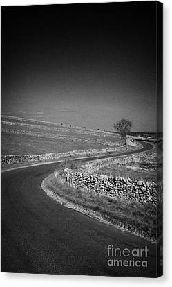 Winding B Road Through The Derbyshire Dales Peak District National Park In Derbyshire England Uk Canvas Print by Joe Fox