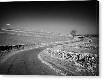 Winding B Road Through The Derbyshire Dales Peak District National Park In Derbyshire Canvas Print by Joe Fox