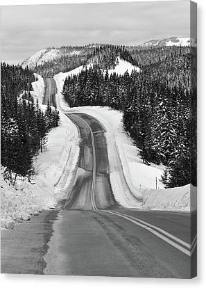 Winding Winter Roads Canvas Print by Peter Bowers
