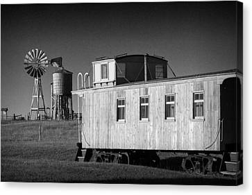 Windmill And Caboose From A Train In 1880's Town Canvas Print by Randall Nyhof