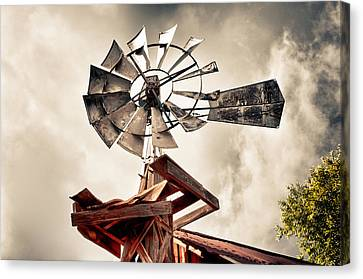 Windmill With Storm Approaching Canvas Print by James Bethanis