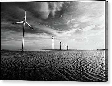 Windmills Out At Sea Canvas Print by Kenneth McNeil