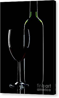 Wine Bottle And Glass Canvas Print by Richard Thomas
