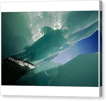 Wolf Creek Flows Through Perennial Ice Canvas Print by Raymond Gehman