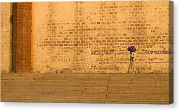 Woman Carrying Bundle On Her Head On Canvas Print by Keith Levit
