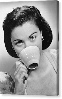 Woman Drinking From Cup Canvas Print by George Marks