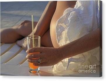 Woman Holding Cocktail Glass While Sunbathing Canvas Print by Sami Sarkis