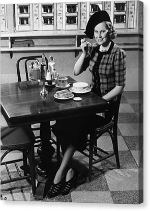 Woman In Fancy Hat Eating Breakfast In Bar, (b&w), Portrait Canvas Print by George Marks